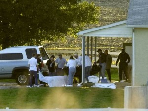 Body of gunman is carried from a schoolhouse in Nickel Mines